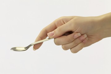 Hand with a spoon