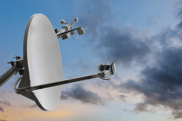 satellite rooftop dish with wind meter and dramatic cloudy sky