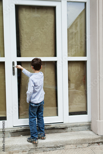 Boy in front of the door