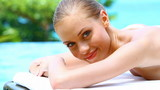Portrait of beautiful woman on spa bed in tropical outdoor