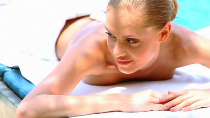 Woman taking hot stones massage in tropical outdoor