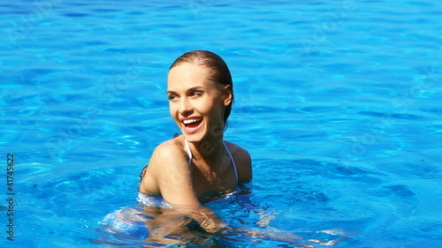 Seductive young woman relaxing in swimming pool