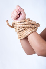 arms tied with strong rope