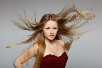 Fashion model posing with hair fluttering in the wind