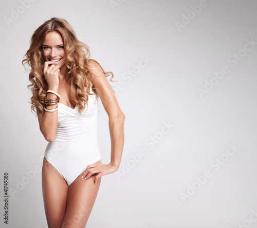 Fototapeta Young sexy woman on grey background