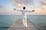 Enjoying pure freedom   Man on a jetty - Fine Art prints
