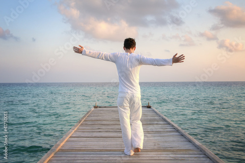Enjoying pure freedom | Man on a jetty