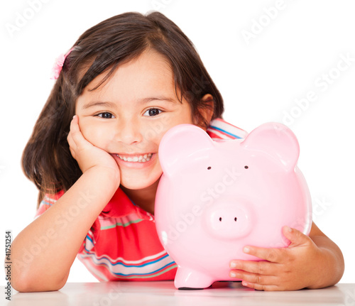 Little girl saving money