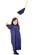 Girl throwing mortarboard