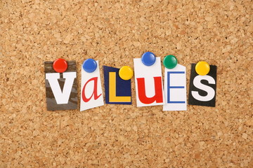 The word values in letters pinned to a cork board