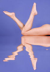Beautiful legs on blue background ..