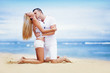 Young beautiful caucasian couple on the beach