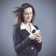 woman business,  text messaging on cell phone