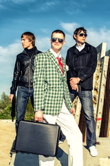 Mafia: Three thugs with a suitcase and weapons