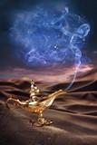 Magic Aladdin's Genie lamp on a desert