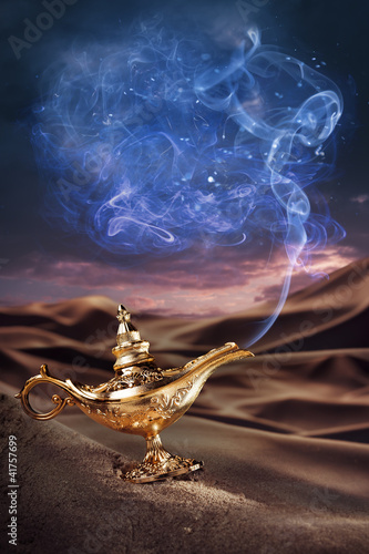 Magic Aladdin's Genie lamp on a desert