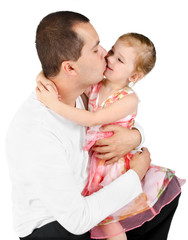 Father kissing little girl