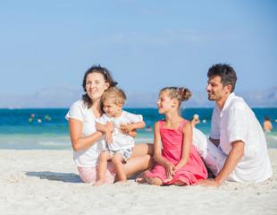 Family of four on tropical beach