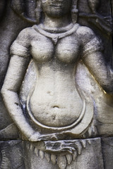 Ancient stone sculpture in Angkor Wat. Cambodia.