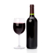 Full red wine glass goblet and bottle