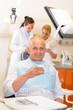 Mature man at dental office surgery