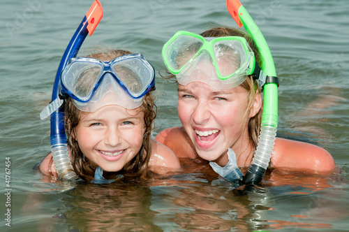 Summer beach - lovely girls diver in the sea