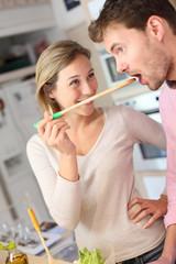 Couple enjoying preparing dinner in kitchen