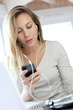 Woman working at home with mobile phone