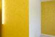 empty room with yellow walls and neon
