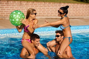 Young couples having fun on summer holiday