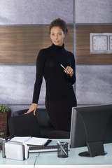 Pretty businesswoman in black in office