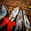 Tools on a rusty background with nuts and bolts