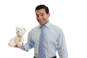 Man holding a knitted teddy bear