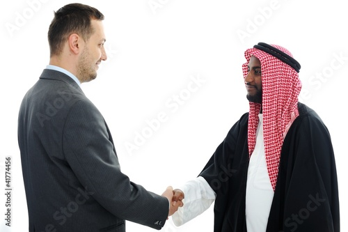 Sheikh making a deal with caucasian businessman