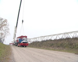 special crane and worker preparatory work for windmill assembly