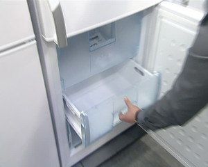 product demonstration in shop. refrigerator door drawers closing