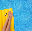 Woman relaxing in a pool - feet close up - 41776289