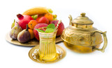 Oriental tea set with fruits on golden plate
