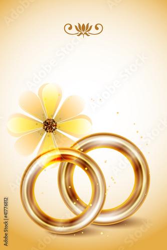 Wedding invitation, with gold wedding rings
