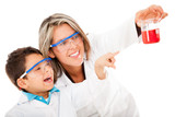 Boy helping mum with an experiment
