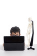 Boy with laptop and human skull