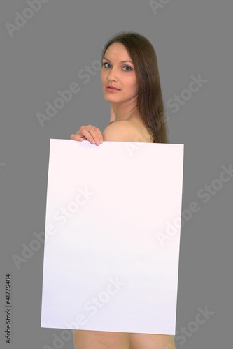 The beautiful girl with a big clean sheet of paper