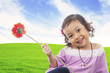 Little girl with red gerbera