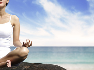 Woman meditating at Beach
