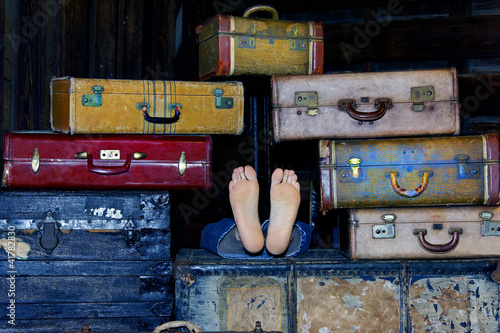 Feet in the Middle of Suitcases
