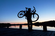 Silhouette of a Cyclist on the Sunset Sky