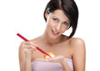 Attractive woman holding sushi with a chopsticks