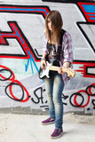 Closeup portrait of a happy young girl with guitar