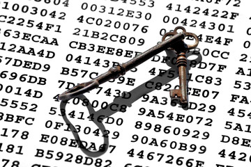 Old-fashioned rusty iron keys on a sheet with encrypted data