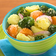 Potato, broccoli, mandarin and onion salad with mayonnaise